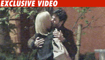 'Keanu & Charlize -- The Long Kiss Goodnight' from the web at 'http://ll-media.tmz.com/2013/08/06/050410-keanu-video-credit-210x120.jpg'
