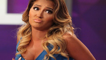 Adrienne Bailon on Getting Her DD Breast Implants Removed!