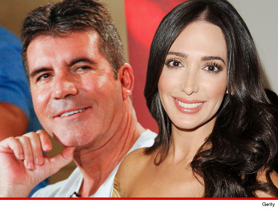 0820_simon_cowell_lauren_silverman_getty