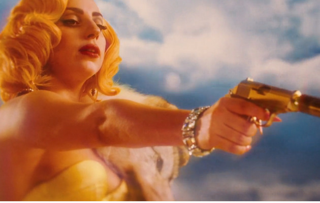 "Lady Gaga Debuts ""Aura"" Lyric Video with Footage from ""Machete Kills"""