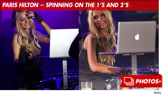 1010_paris_hilton_dj_spinning_footer
