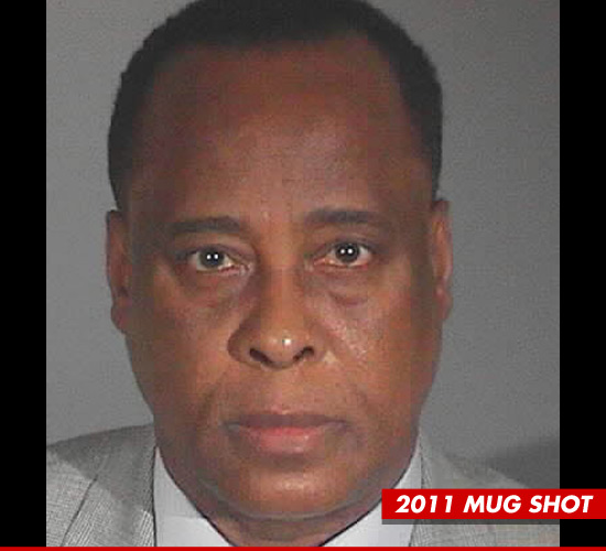 1028_conrad_murray_mug_2011_b