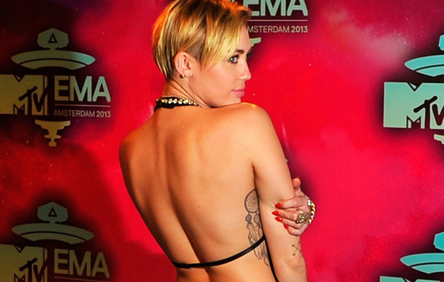 Whoa! See Miley Cyrus' Revealing EMA Outfits!