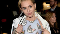 "Miley Cyrus Performs ""Wrecking Ball"" ... with a Lip-Syncing Cat?!"