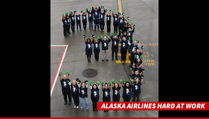 1217-alaska-airlines-crew-hard-at-work