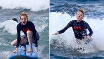 Emma Stone -- Wipes Out Surfing in Hawaii