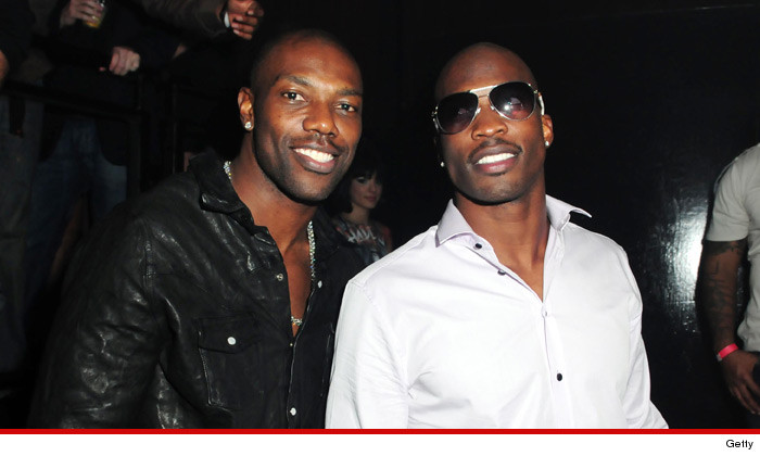 Photo of Terrell Owens & his friend American Football player  Chad Johnson - NFL team