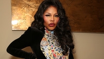 Lil' Kim Five Months Pregnant -- Rapper Debuts Baby Bump at Fashion Week