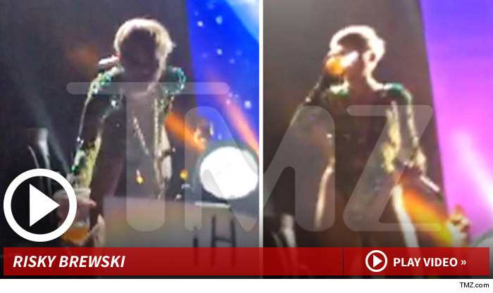 Miley Cyrus -- Snatches Beer in High-Risk Move