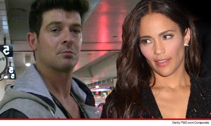 0224-robin-thicke-and-wife-getty-tmz-02