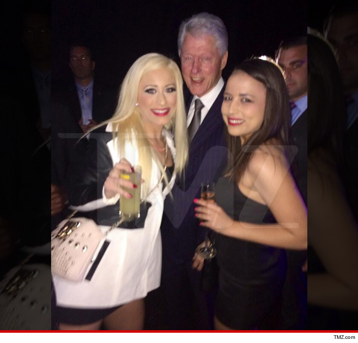 Bill Clinton poses with two prostitutes named Barbie Girl and Ava Adora