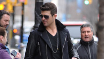Robin Thicke Steps Out Smiling Without His Wedding Ring in NYC