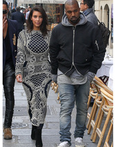 Kim Kardashian Sports Pair of Bizarre Dresses With Kanye West in Paris