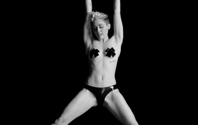 Miley Cyrus Dances Topless in New Concert Video -- Check it Out!