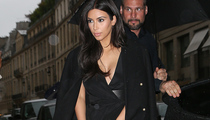 Kim Kardashian Flaunts Major Cleavage (And A Lot of Leg) in Paris