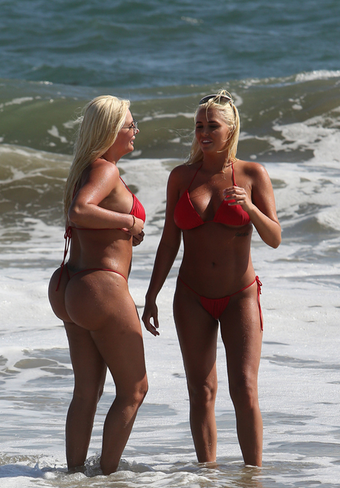 <span>Former Playboy playmates </span><span>Karissa and Kristina Shannon </span><span>frolicked on the beach in the Pacific Palisades yesterday with some unusual beach accessories ... burgers and fries.</span>