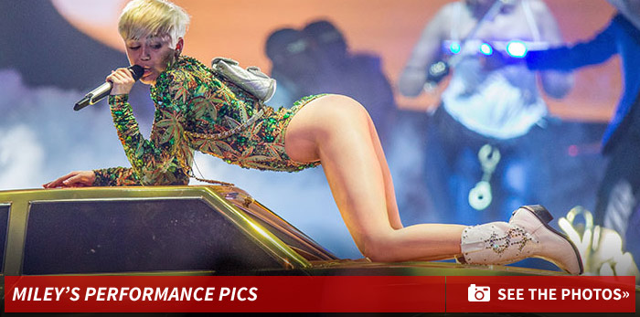 0618_miley_cyrus_performace_photos_pics_footer