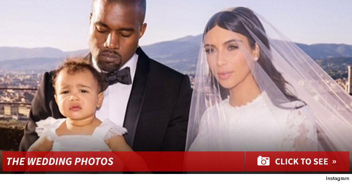 0619_kanye_kim_kardashian_wedding_footer