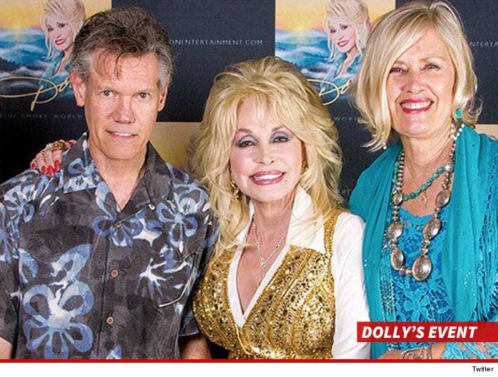 0619-randy-travis-dolly-parton-twitter-WITH-SWIPE-2