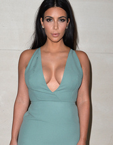 Kim Kardashian Attends Paris Fashion Week (and So Does Her Cleavage)