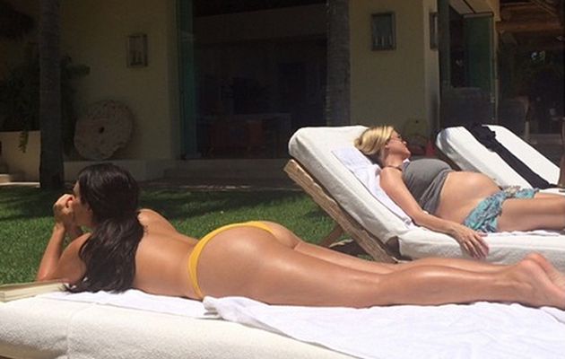 Kim Kardashian Sunbathes Topless and Flashes Booty in Revealing Bikini