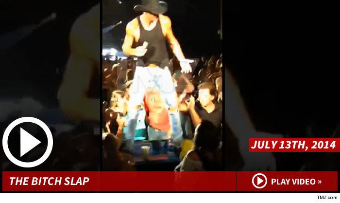 Tim McGraw Slapping Woman