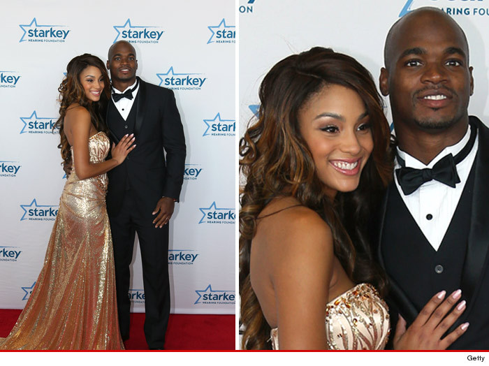 0726_adrian_peterson-with-wife_getty3