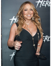 Mariah Carey Flaunts Major Cleavage, Lots of Leg at