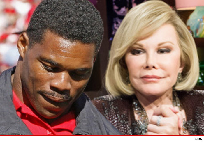 0904_herschel-walker_joan_rivers_getty