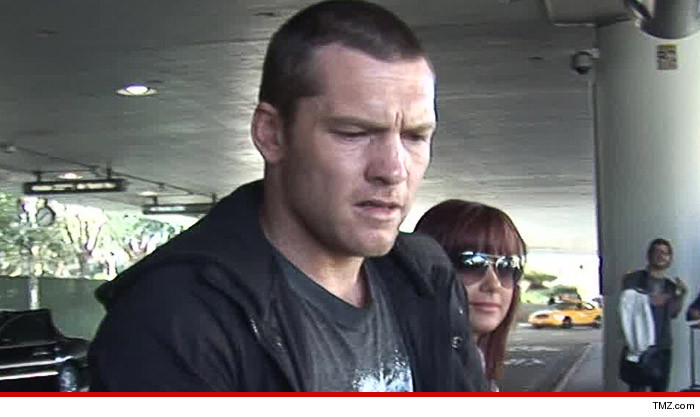 0912-sam-worthington-tmz-01