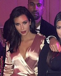 Kim and Kourtney Kardashian Flash Lots of Leg at Star-Studded Wedding
