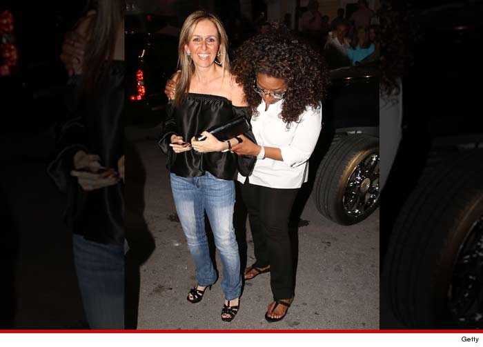 1027-subasset-oprah-driver-foot-getty