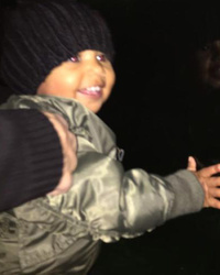 North West Finally Smiles In New Pics -- And She's Getting Big!