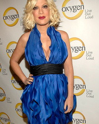 "What's Going on with Tori Spelling's Boobs? Doc Says They're ""Alm"