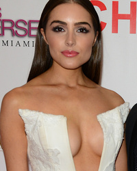 Nick Jonas' Girlfriend Olivia Culpo Flashes a Whole Lotta Leg & Cleavage at Mis