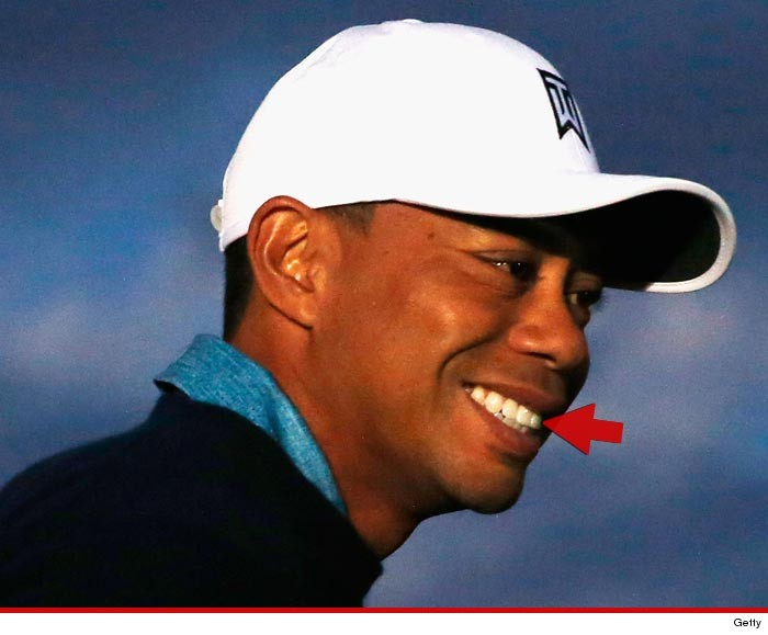 0127-tiger-woods-tooth-getty-01
