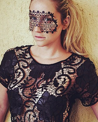 Kesha Poses in See-Through Top & Lace