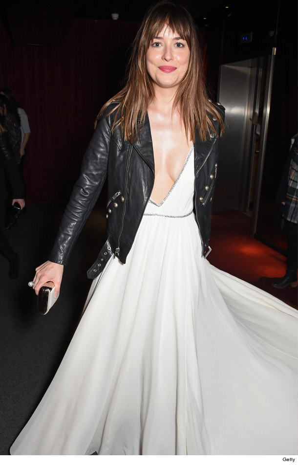 Dakota Johnson Stuns In Very Low Cut Dress At London
