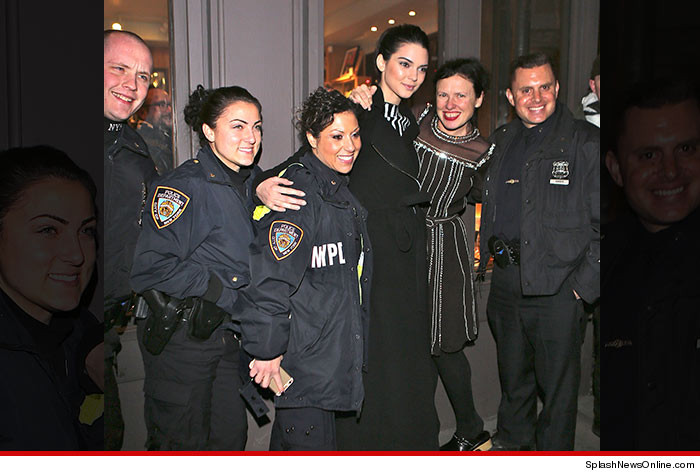0215-kendall-jenner-pose-police-book-marc-SPLASH-01