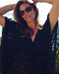Cindy Crawford Looks Stunning While Lounging by Pool After Untouched Photo Leak