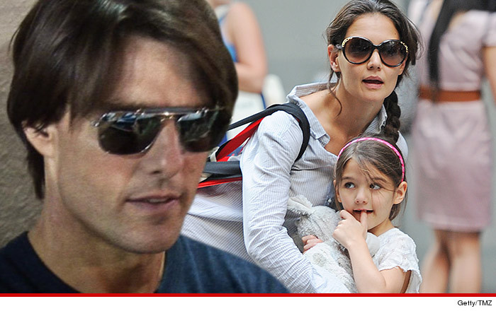 0317_tom_cruise_katie_holmes_suri_tmz_getty