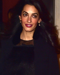 Amal Clooney Flashes Bare Belly in Wild 70's-Inspir