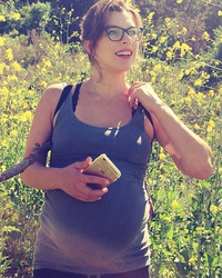 Milla Jovovich Flaunts Big Baby Bump with Just Days to Go