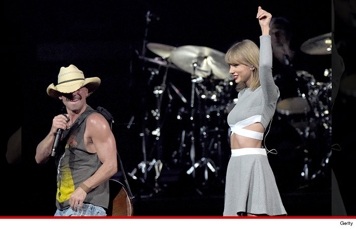 0327_taylor_swift_on_stage_with_kenny_getty_SUB