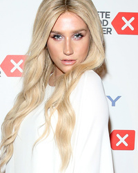 Kesha Wows in White at Cancer