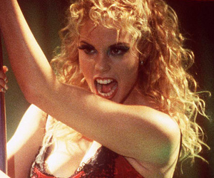 "Elizabeth Berkley Reflects on ""Authentic"" Moment In ""Showgirls&quo"