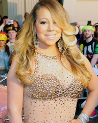 Mariah Carey Shows Off Fit Physique in Nude Sparkly Gown