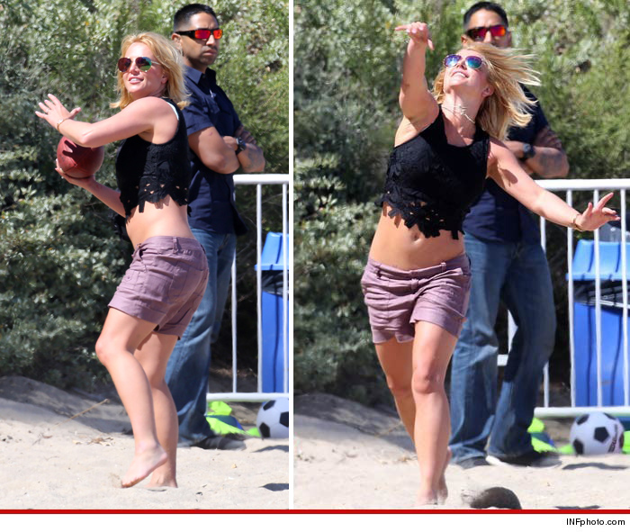 0504-britney-spears-football-beach-splash-fix-5