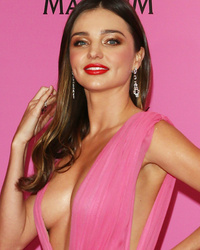Miranda Kerr Stuns In Plunging Pink Gown at Cannes Film Festival!