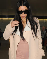 Pregnant Kim Kardashian Goes Makeup-Free, Sports Skin-Tight Pink Jumpsuit